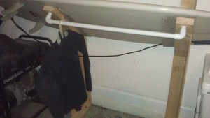 Surfboard wetsuit clothes rack