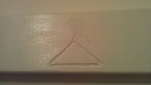 Clothes hanger symbol